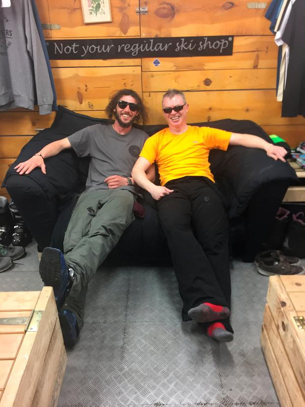 Joe with Chris Gardiner: Going through the door of Ski Pas is to enter a different world