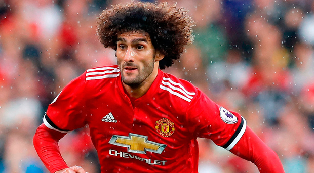 United midfielder Marouane Fellaini faces two weeks on the sidelines with a knee injury. Photo:Martin Rickett/PA