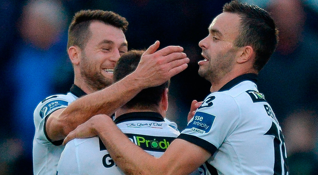 Brian Gartland (centre) is congratulated by Thomas Stewart( left) and Robbie Benson afer scoring Dundalk's first goal in Ballybofey. Photo: Oliver McVeigh/Sportsfile