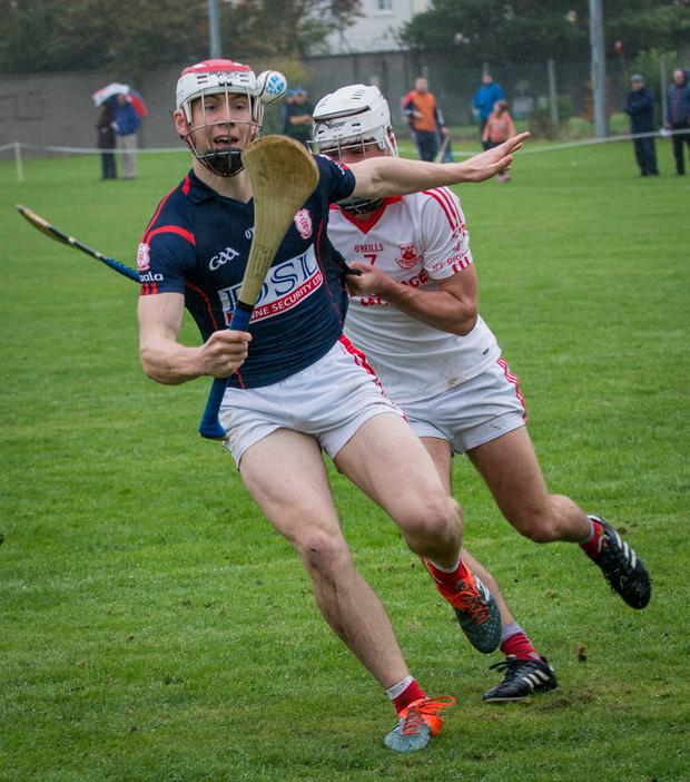Cuala's Con O'Callaghan tries to get away from St Brigid's Donnacha Ryan during yesterday's Dublin SHC quarter-final at O'Toole Park. Photo: Doug O'Connor