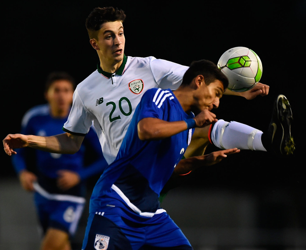 Ireland's Neil Farrugiain action against Petros Ioannou of Cyprus during the UEFA European U19 Championship Qualifier. Photo: Seb Daly/Sportsfile