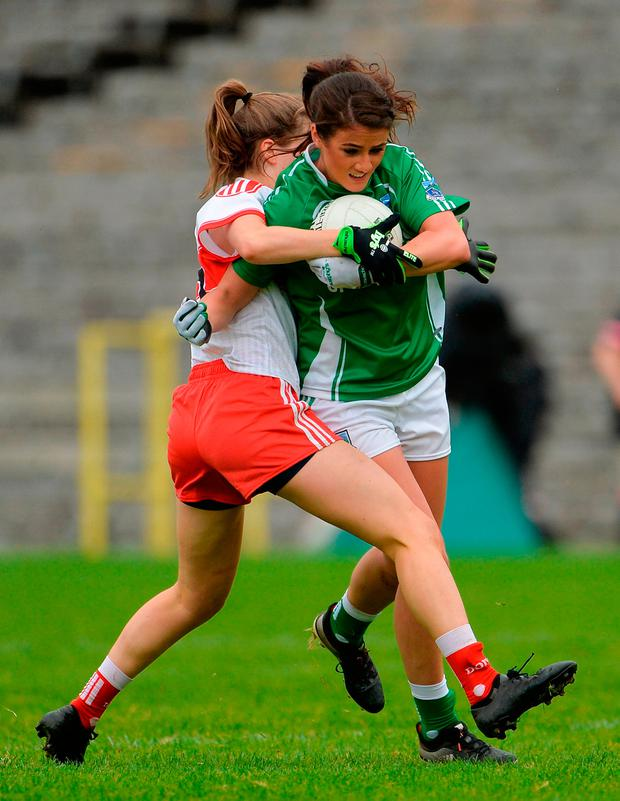 Joanne Doonan of Fermanagh in action against Katie Holly of Derry. Photo by Oliver McVeigh/Sportsfile