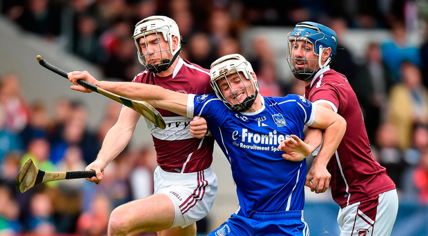 Thurles Sarsfields's Pa Burke of feels the squeeze from Brendan Maher (L) and Ciaran Cowan of Borris-Ileigh. Photo by Matt Browne/Sportsfile