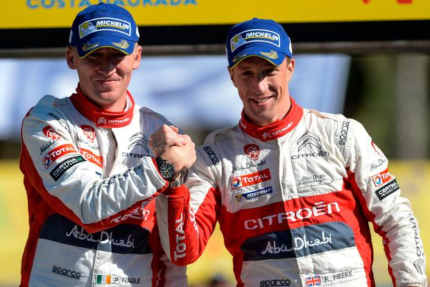 Paul Nagle and Kris Meeke (right) celebrate on the podium after winning the 53th Rally of Catalonia yesterday. Photo: Getty Images