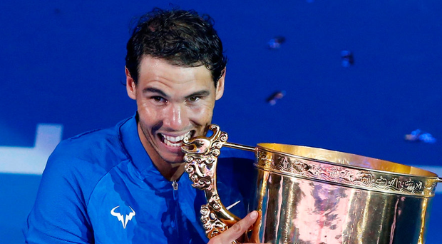 Rafael Nadal of Spain celebrates with the China Open trophy. Photo: Reuters