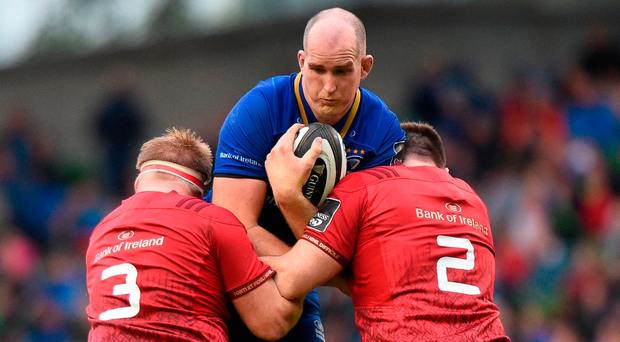 Devin Toner of Leinster is tackled by Munster's John Ryan and Niall Scannell. Photo by Cody Glenn/Sportsfile