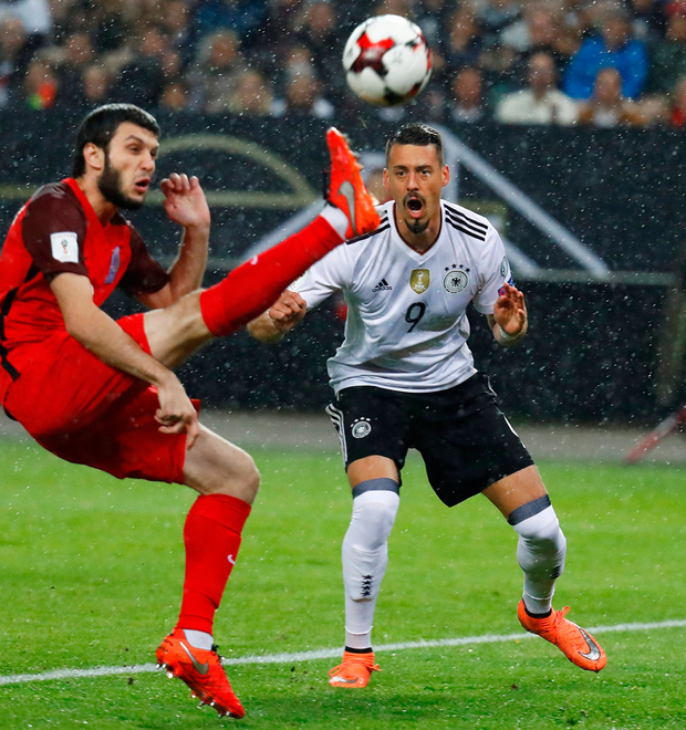 Germany's Sandro Wagner challenges for the ball during the match against Azerbaijan. Photo: Pfaffenbach/Reuters