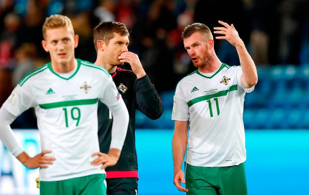 Northern Ireland's Chris Brunt (right) and goalkeeper Michael McGovern after the 2018 FIFA World Cup Qualifying Group C match at the Ullevaal Stadion, Oslo. Photo: PA