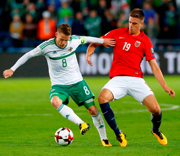 Northern Ireland's Steaven Davis (left) and Norway's Markus Henriksen battle for the ball during their World Cup Qualifying match. Photo: Martin Rickett/PA