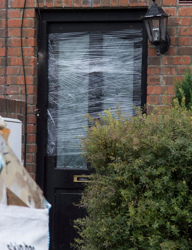 Damaged door of the house that was shot at in Finglas