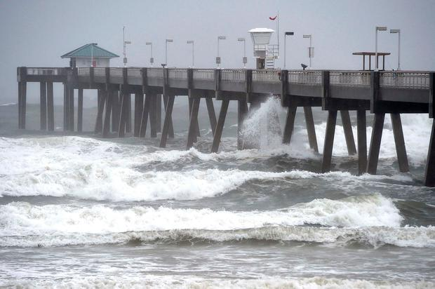 Waves caused by Hurricane Nate pound the Okaloosa Island Fishing Pier. Credit: AP Photo