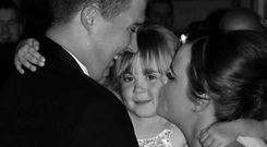Hannah, her daughter, and her husband on the couple's wedding day