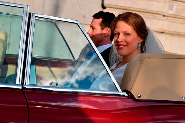 Prince Philip of Serbia, also known as Filip Karadjordjevic and his bride Danica Marinkovic leave the Belgrade cathedral after their wedding ceremony on October 7, 2017.