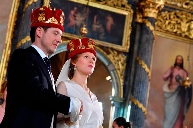 Prince Philip of Serbia, also known as Filip Karadjordjevic and his bride Danica Marinkovic attend their wedding ceremony in the Belgrade cathedral on October 7, 2017