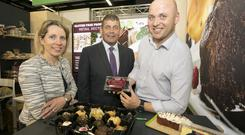 Minister of State at the Department of Agriculture, Food and the Marine, Andrew Doyle, Tara McCarthy, Bord Bias CEO with Trevor Dunne from Colemore Foods at Anuga. Photo Chris Bellew /Fennell Photography.