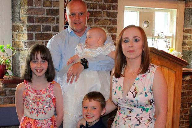 Jenny with her partner Aiden and their children Ella, Jack and Penny
