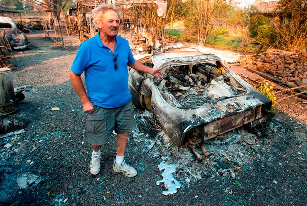 Resident Louis Reavis views his burned classic Corvette at his home in Napa, California on October 9, 2017, as multiple wind-driven fires continue to whip through the region. / AFP PHOTO / JOSH EDELSONJOSH EDELSON/AFP/Getty Images