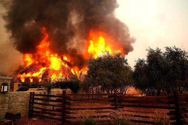 Fire consumes a barn as an out of control wildfire moves through the area on October 9, 2017 in Glen Ellen, California. (Photo by Justin Sullivan/Getty Images)