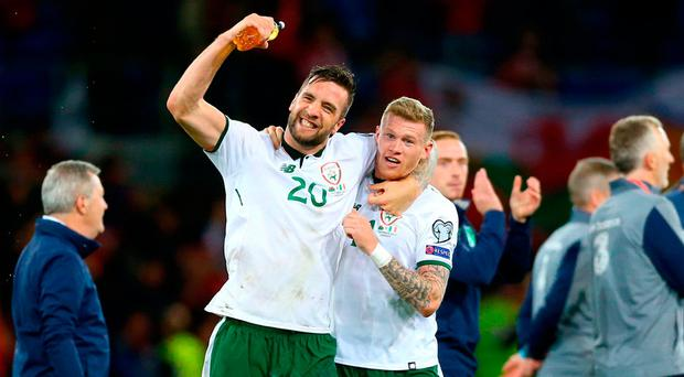 Shane Duffy celebrates with goalscorer James McClean after the final whistle at the Cardiff City Stadium. Photo: PA