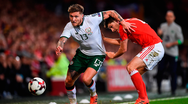 Jeff Hendrick skips by Wales' Ben Davies during last night's World Cup qualifier at Cardiff City Stadium. Photo: Sportsfile