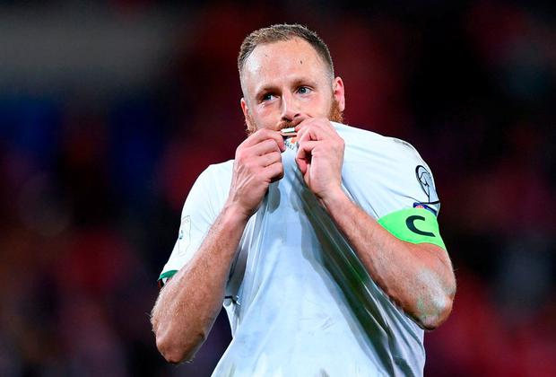 Captain David Meyler celebrates by kissing the Ireland badge following their victory in Wales. Photo: Stephen McCarthy/Sportsfile