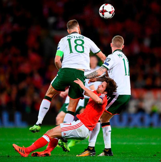 Joe Allen finds himself as the meat in the sandwich between David Meyler and James McClean in the incident which saw the Welshman substituted. Photo: STEPHEN McCARTHY/SPORTSFILE