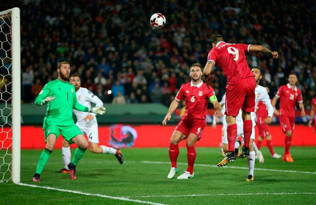 Aleksandar Mitrovic heads at goal. Photo: REUTERS/Marko Djurica