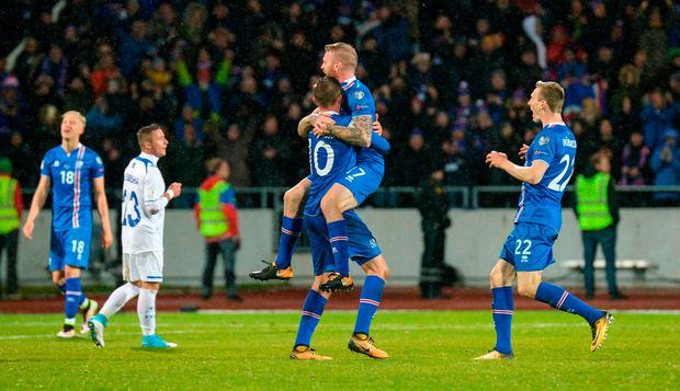 Iceland midfielders Gylfi Sigurdsson and Aron Gunnarsson celebate. Photo: Getty
