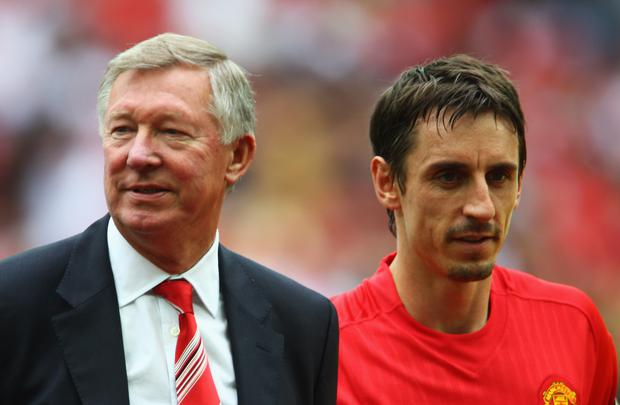 LONDON - AUGUST 10: Sir Alex Ferguson manager of Manchester United (L) and captain Gary Neville look on prior to the FA Community Shield match between Manchester United and Portsmouth at Wembley Stadium on August 10, 2008 in London, England. (Photo by Phil Cole/Getty Images)