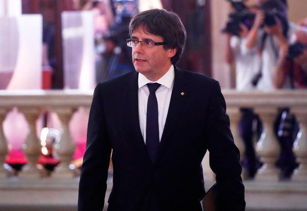 Catalan President Carles Puigdemont arrives at the Catalonian regional parliament in Barcelona, Spain, October 10, 2017. REUTERS/Juan Medina