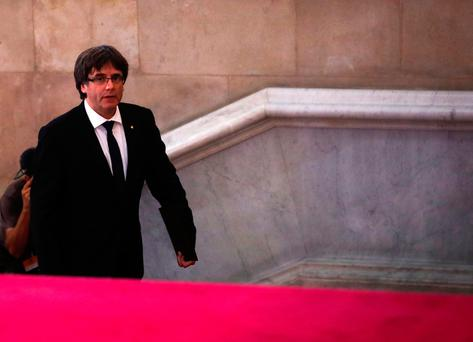 Catalan President Carles Puigdemont walks up the stairs as he arrives at the Catalonian regional parliament in Barcelona, Spain, October 10, 2017. REUTERS/Juan Medina