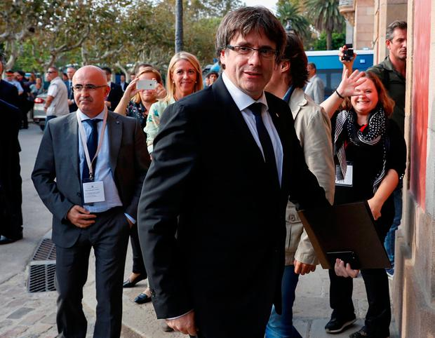Catalan President Carles Puigdemont arrives at the Catalonian regional parliament in Barcelona, Spain, October 10, 2017. REUTERS/Rafael Marchante