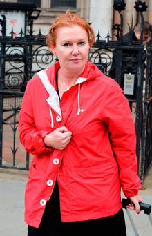 Barbara Spain-Radseresht who is in a divorce court fight with Mehrdad Radseresht leaves the Royal Courts of Justice in London. John Stillwell/PA Wire