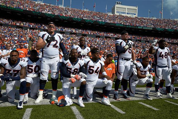 Denver Broncos Garett Bolles (72), Derek Wolfe (95) and Shaquil Barrett (48) with teammates kneeling and linking arms in a show of solidarity during the National Anthem before game vs Buffalo Bills at Ralph Wilson Stadium.CREDIT: David E. Klutho (Photo by David E. Klutho /Sports Illustrated/Getty Images)