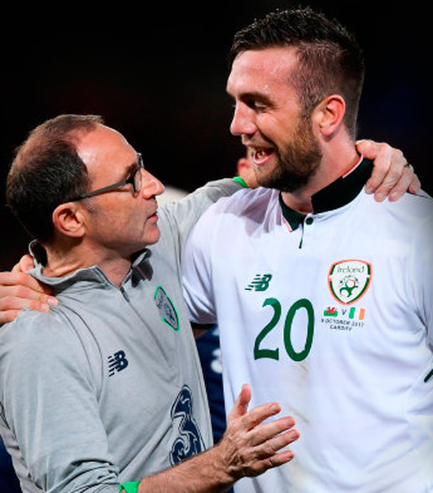 Ireland manager Martin O'Neill and defender Shane Duffy celebrate the win over Wales in Cardiff on Monday. Photo: Sportsfile