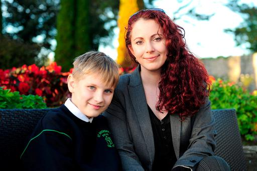 After-school care issue: Ekaterina Koneva with 11-year-old son Denis. Photo: James Flynn/APX