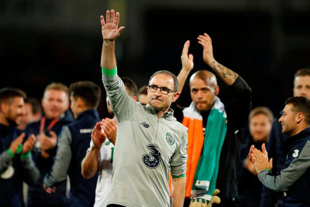 Martin O'Neill acknowledges supporters after Ireland's famous victory in Cardiff. Photo: REUTERS