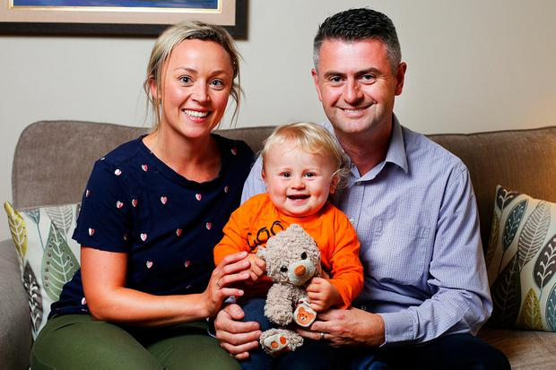 Siobhan McDermott with her 18 month old son Christopher and husband Brian Redmond. Photo: Steve Humphreys