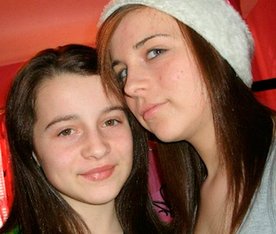 Shannon Gallagher (right) and her late sister Erin (13). The 15-year-old was found dead in her bedroom by her foster mum