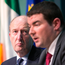 Transport Minister Shane Ross (left) listens to Junior Minister Brendan Griffin