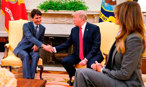 Canada's Prime Minister Justin Trudeau shakes hands with US President Donald Trump as US first lady Melania Trump looks on as they meet about the Nafta trade agreement at the White House in Washington yesterday Photo: Reuters/Jonathan Ernst