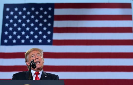 US President Donald Trump speaks on tax reform inside a hangar at the Harrisburg International Airport on October 11, 2017 in Middletown, Pennsylvania. / AFP PHOTO / MANDEL NGANMANDEL NGAN/AFP/Getty Images