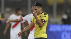 Radamel Falcao of Colombia gestures during a match between Peru and Colombia as part of FIFA 2018 World Cup Qualifiers at Monumental Stadium on October 10, 2017 in Lima, Peru. (Photo by Daniel Apuy/Getty Images)