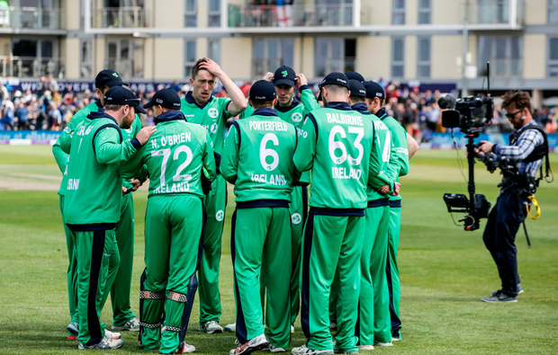 Ireland players in a huddle around captain William Porterfield