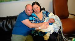 Krystle and Trevor Hunt with baby Eli