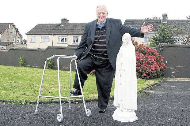Des Fitzgerald (82), Greystones, Limerick, with his 'miracle' statue of Our Lady. Photo: Press 22
