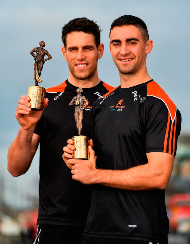 Galway's Gearóid McInerney and Dublin's James McCarthy with their PwC Player of the Month awards for September Photo: Brendan Moran/Sportsfile