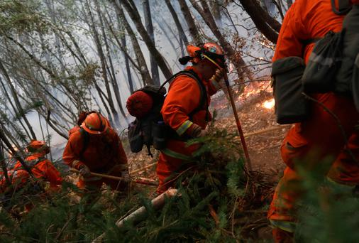 Firefighters work to contain the Tubbs wildfire outside Calistoga, California Photo: REUTERS/Jim Urquhart