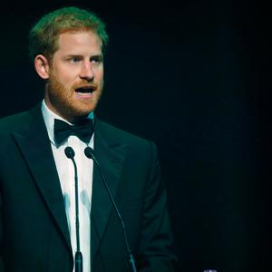 Britain's Prince Harry receives a posthumous Attitude Legacy Award on behalf of his mother Diana, Princess of Wales, at the Attitude Awards in London, Britain October 12, 2017