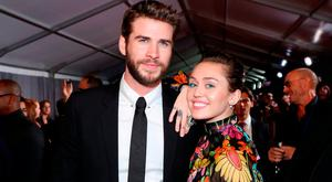 Actor Liam Hemsworth (L) and Miley Cyrus at The World Premiere of Marvel Studios'